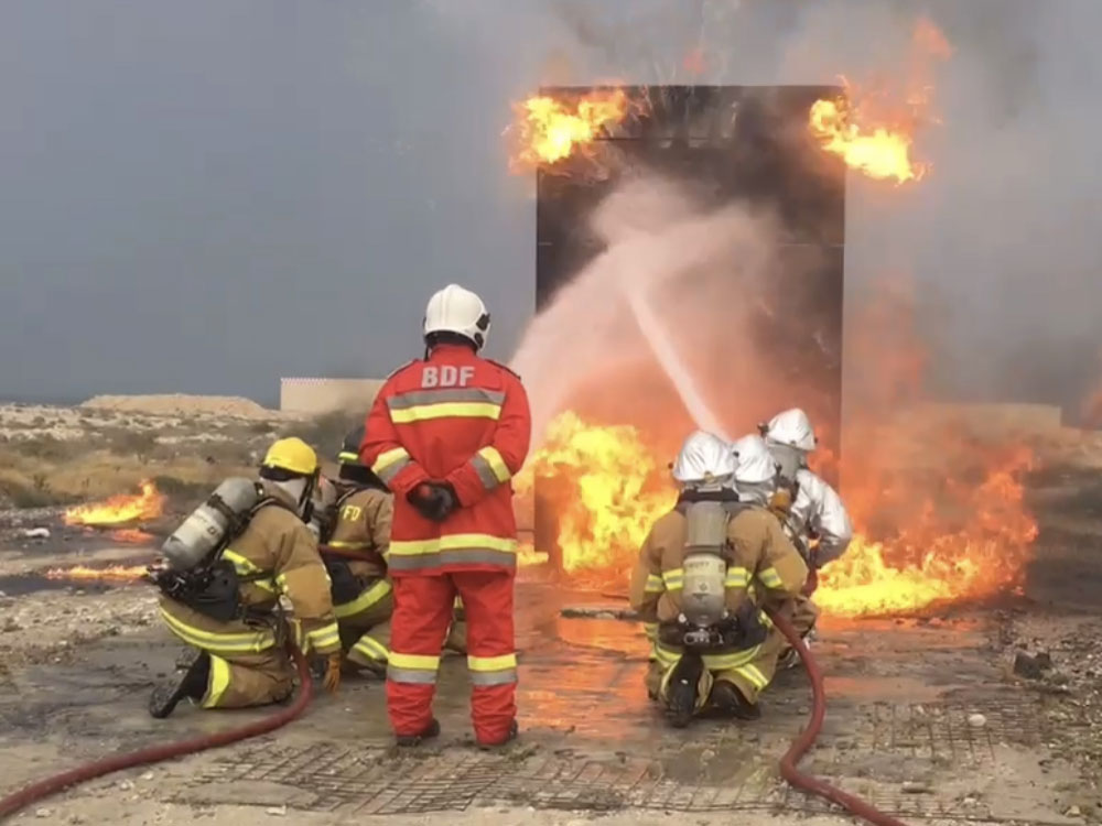firefighters putting out training fire