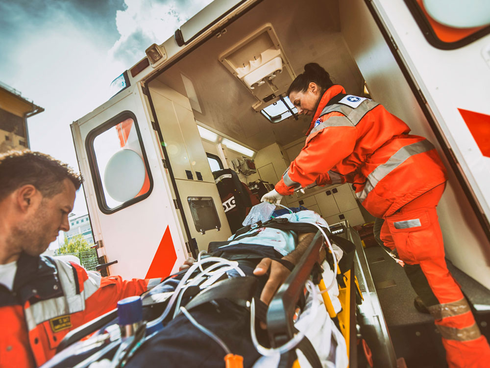 ambulance workers with patient